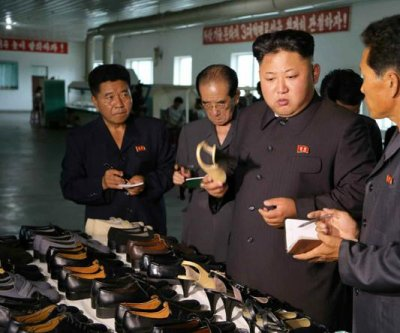 Kim Jong Un visits North Korea shoe factory, holds hands with workers