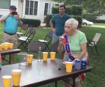 Grandma celebrates 100th birthday with game of beer pong