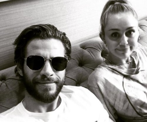 Liam Hemsworth posts photo with Miley Cyrus: 'My little angel'