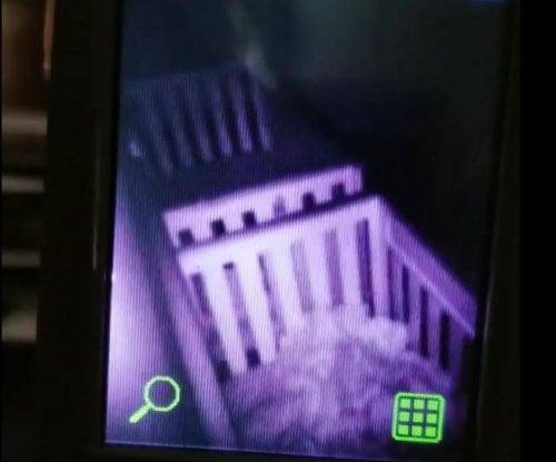 Baby monitor catches twin toddlers belting the Eagles fight song