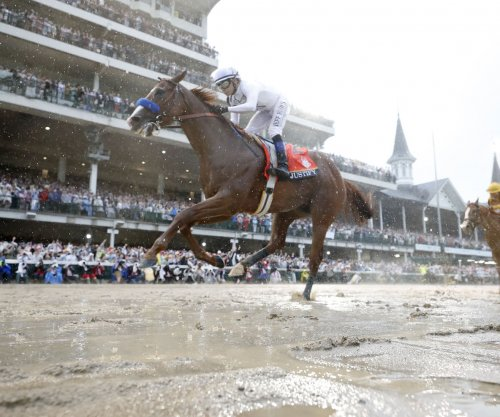 Justify races to Kentucky Derby victory