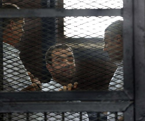 Al Jazeera journalists' retrial begins in Cairo