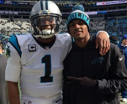 Carolina Panthers' Cam Newton takes picture with Clemson's Deshaun Watson before game