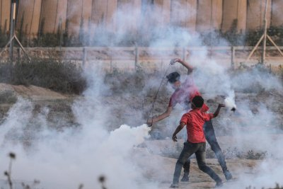 Palestinian protests turn violent after Israeli police kill a man