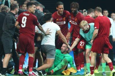 Fan injures Liverpool goalie Adrian during celebration