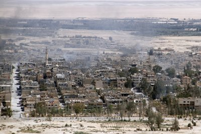 At least 32 killed in two suicide bombings on Syria security bases