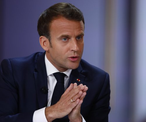 France's Macron pledges to cut taxes in response to Yellow Vest protests
