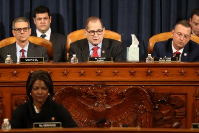 House judiciary committee votes to impeach Trump on two charges