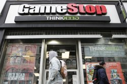 U.S. markets fall amid negative Fed outlook, GameStop speculation