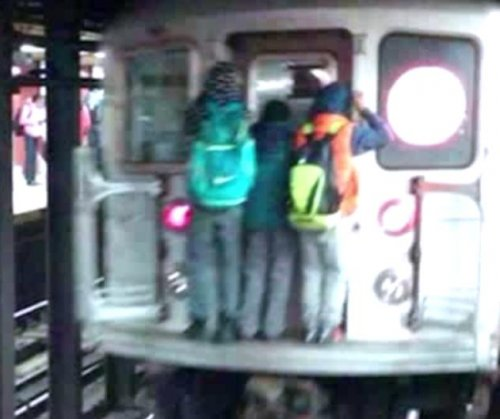 'Subway surfing' kids photographed on New York train