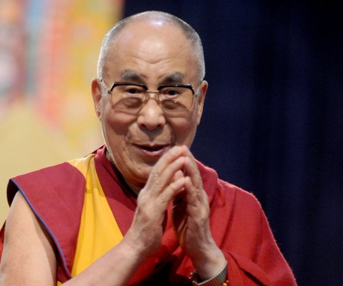 Dalai Lama says potential female successor would have to be 'attractive'