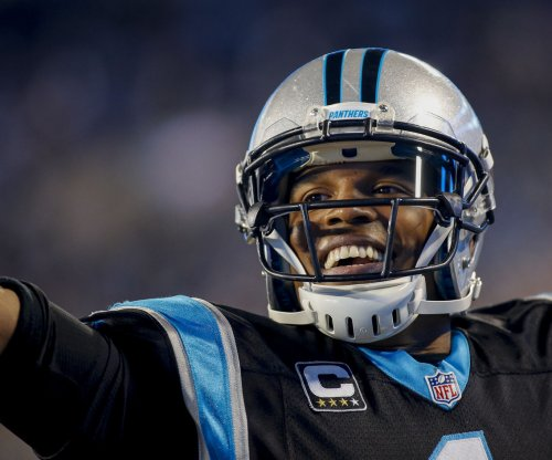 Carolina Panthers pound Tampa Bay Buccaneers, lock up NFC's top spot