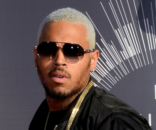 With search warrant, LAPD ends long standoff with rapper Chris Brown