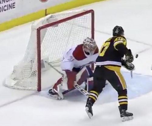 Sidney Crosby juggles puck on stick for goal
