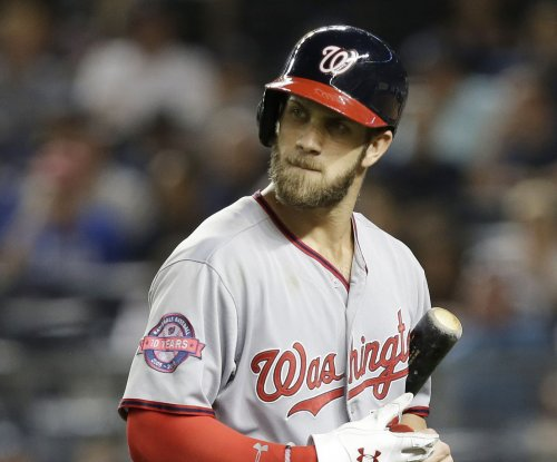 Washington Nationals' Bryce Harper leaves game with apparent leg injury