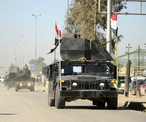 Iraqi forces capture village en route to Mosul airport