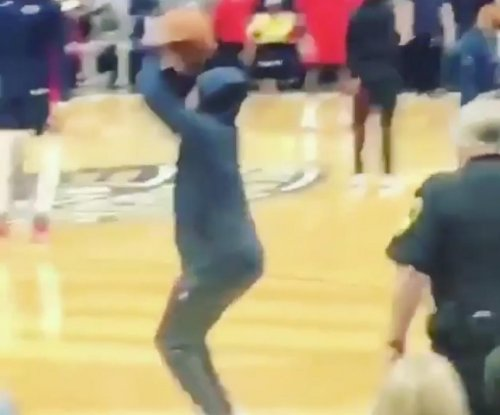 Pelicans fan pretends to be part of team, shoots in warm-up