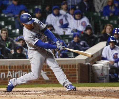 Logan Forsythe's 13th-inning hit lifts Los Angeles Dodgers over St. Louis Cardinals