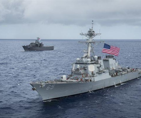 Japanese tug slightly damages U.S. destroyer