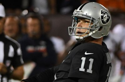 Agent: Janikowski intends to keep playing