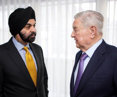 George Soros, Mastercard partner on refugee aid delivery