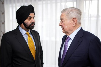 George Soros, Mastercard partner on refugee aid delivery