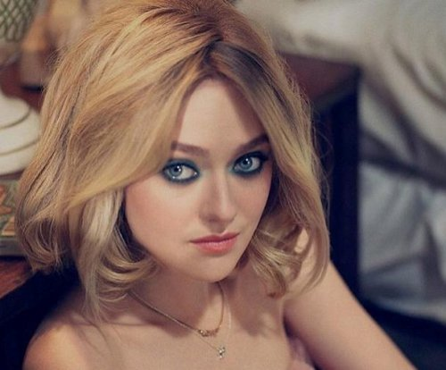 Dakota Fanning poses for sultry Vs. magazine shoot