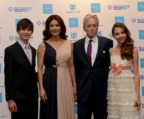 Michael Douglas, Catherine Zeta-Jones walk red carpet with their kids