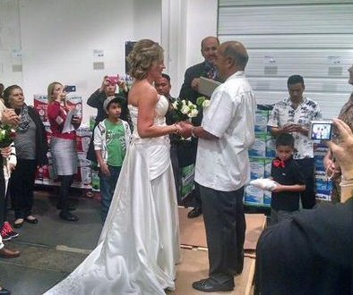 Newlyweds walk down the 'aisle' at Costco
