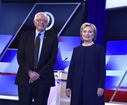 Clinton, Sanders accuse Trump of inciting violence at town hall event