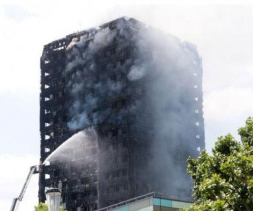 Cladding on 600 buildings could burn, British PM May says