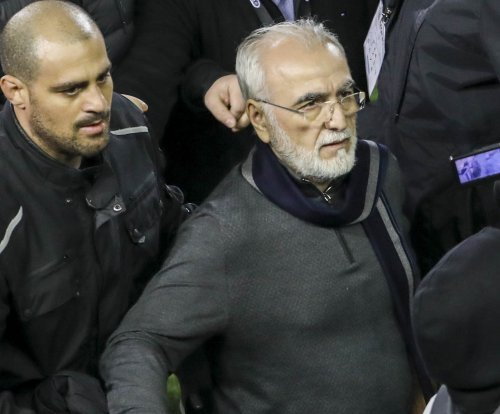 Greek soccer team owner invades field while carrying gun
