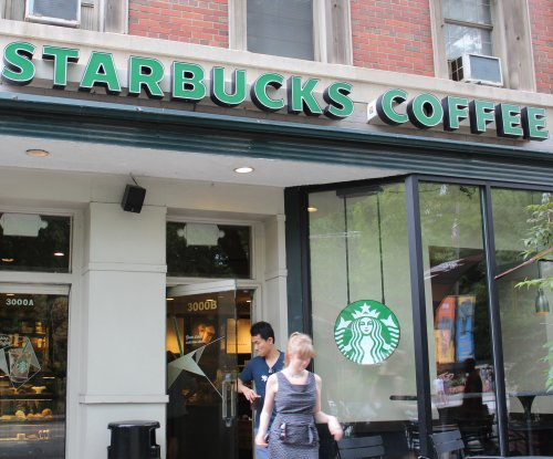 Starbucks expands sale of beer, wine and dinner plates