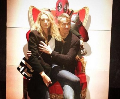 Blake Lively, Ryan Reynolds pose on 'Deadpool' throne