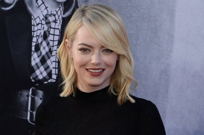 Emma Stone says male co-stars took pay cuts to ensure parity