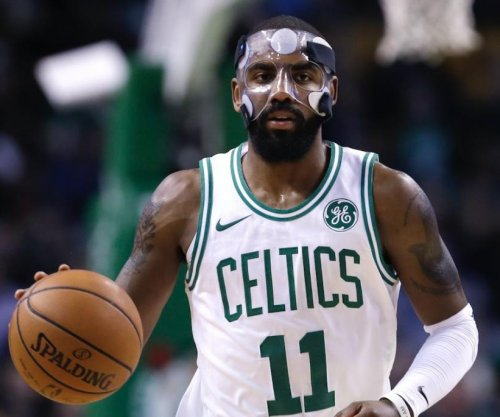 Boston Celtics guard Kyrie Irving out with quad injury