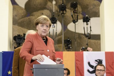 Merkel's conservatives join coalition with social Democrats