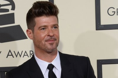 Robin Thicke introduces newborn daughter Lola
