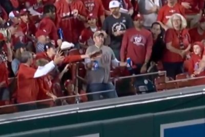 Man carrying beers takes baseball to the chest, doesn't spill