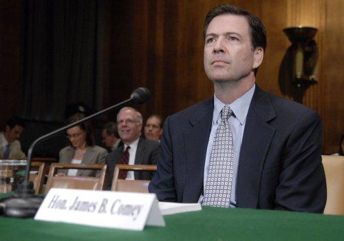 Obama selects former Bush Justice Dept. official to head FBI