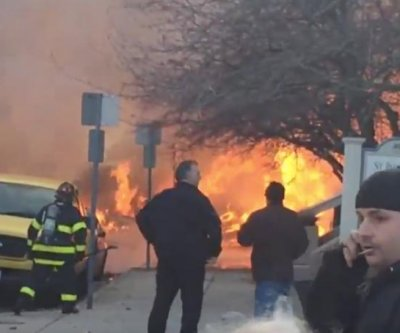Firefighters battle 10-alarm blaze in Cambridge, Mass.