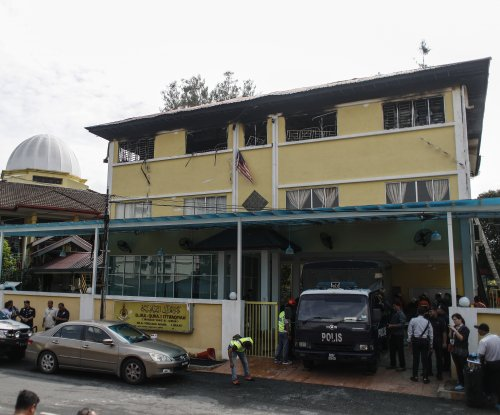 Blaze at Malaysia school kills 23, mostly children