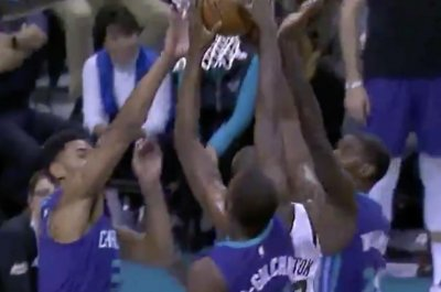 Three Charlotte Hornets players block shot at same time