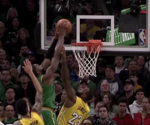 Celtics' Jaylen Brown gets 'bucket list' dunk on Lakers' LeBron James