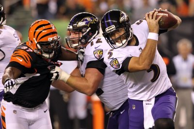 Baltimore Ravens QB Joe Flacco practices, listed as questionable