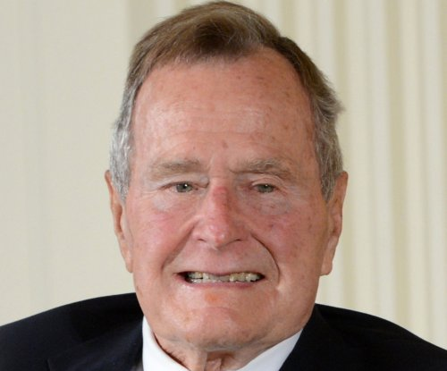Elder Bush still in the hospital, to remain through the weekend