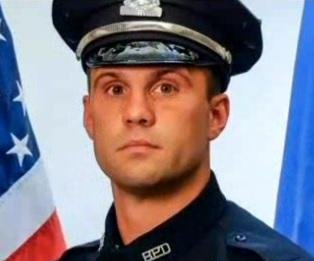 Officer decorated after Boston Bomber shootout ambushed, badly wounded