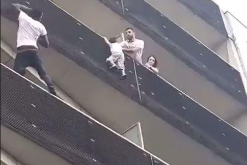 Paris man climbs four stories to save baby hanging from ledge