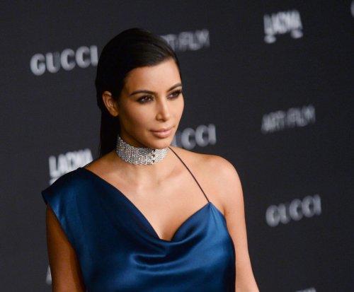 Kim Kardashian debuts revealing 'Selfish' book cover