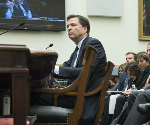 FBI director, Apple lawyer square off on Capitol Hill in fight to unlock suspect's iPhone